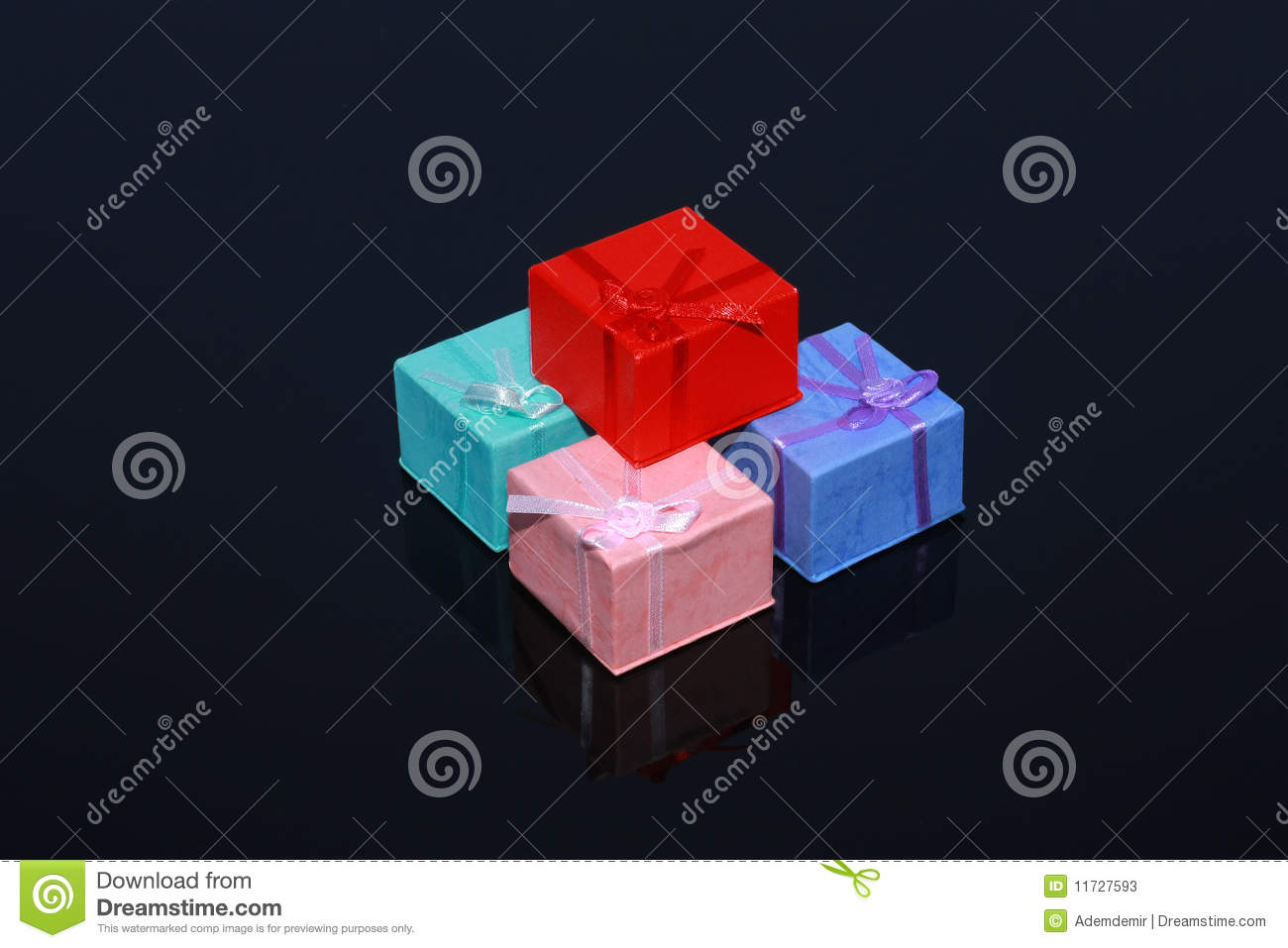 Four colorful gift boxes isolated on black