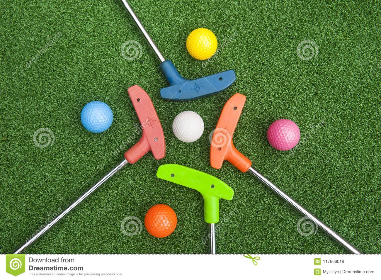 Four Mini Golf Putters with Balls
