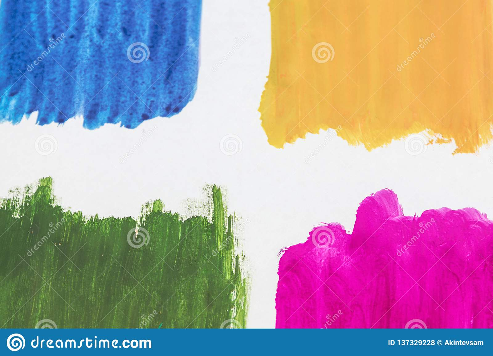 Four colors of watercolor paint on a white background