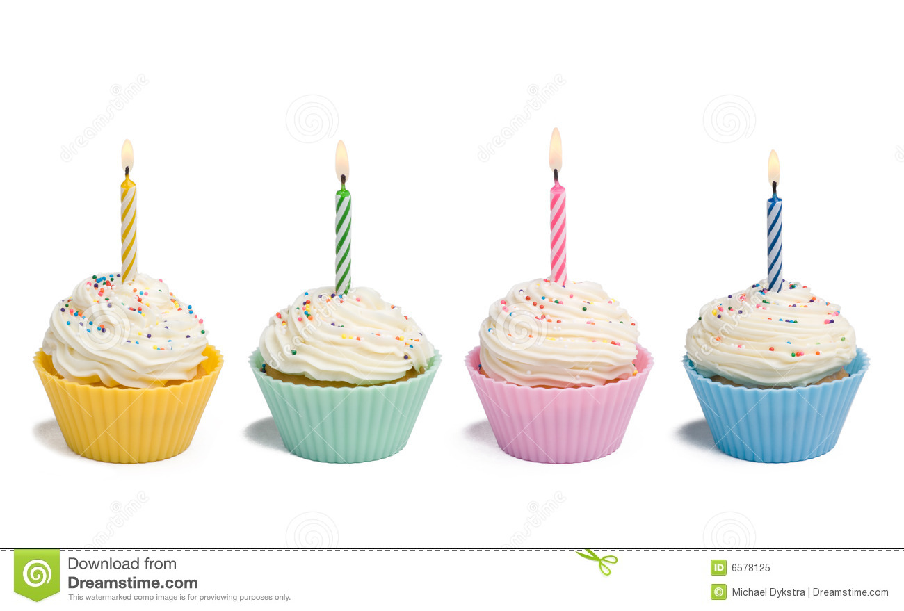 Four Cupcakes With Candle Royalty Free Stock Photo - Image: 6578125