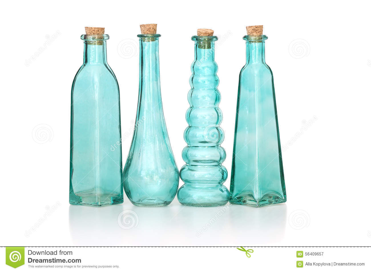Four Cyan Colored Glass Bottles Of Different Shapes Stock
