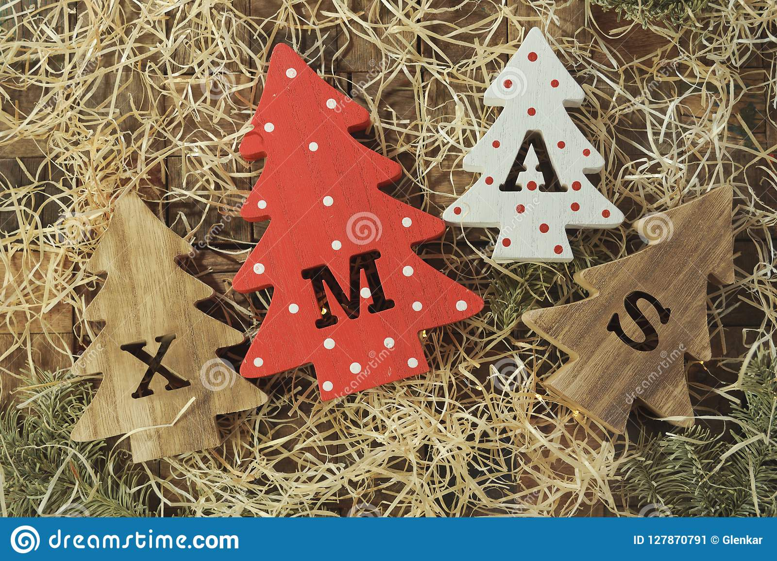 Four Decorative Wooden Christmas Trees With Carved Letters Xmas And Delicacy In The Form Of A Small Bones For Pets Top View Stock Image Image Of Composition Brown 127870791