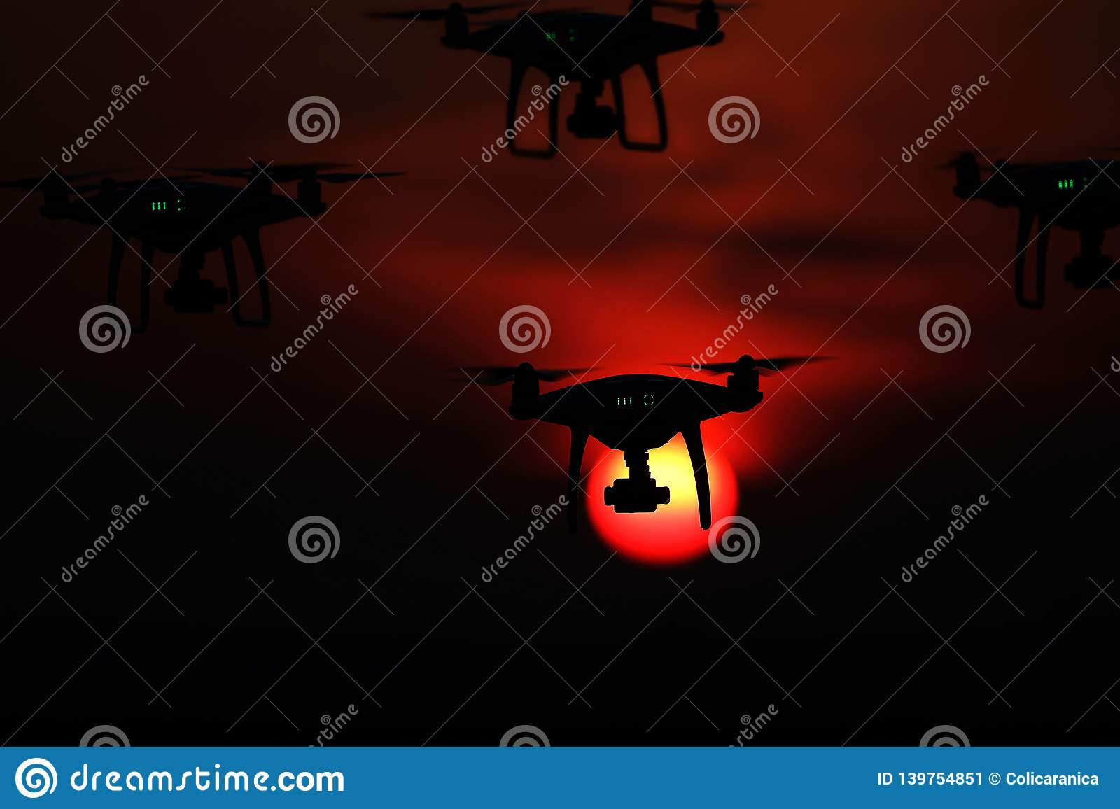 Silhouette of drones in the sky, red sunset