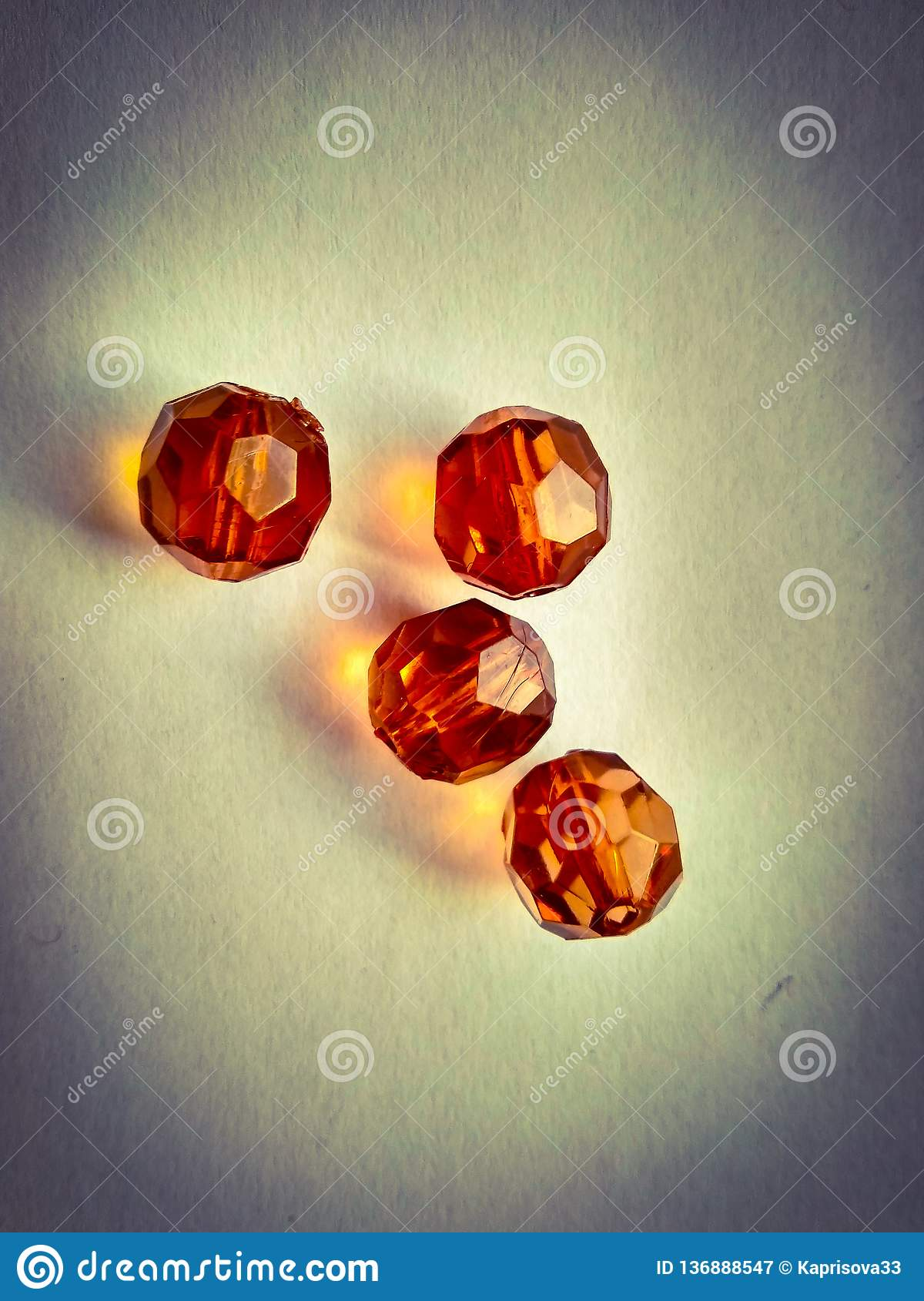 Four faceted beads