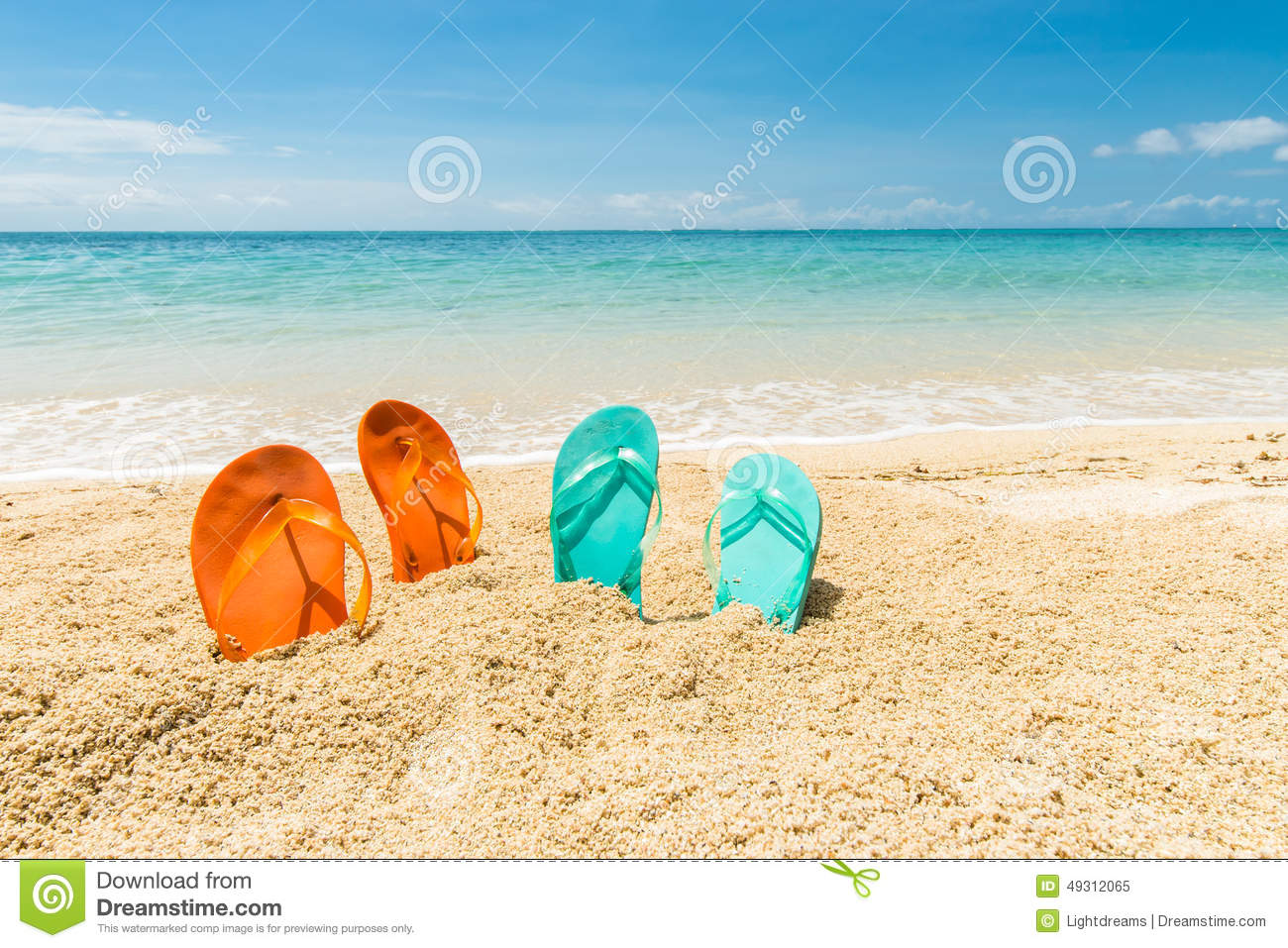 d52e736f2 Four flip-flops. Travel background with two pair of orange and green flip-