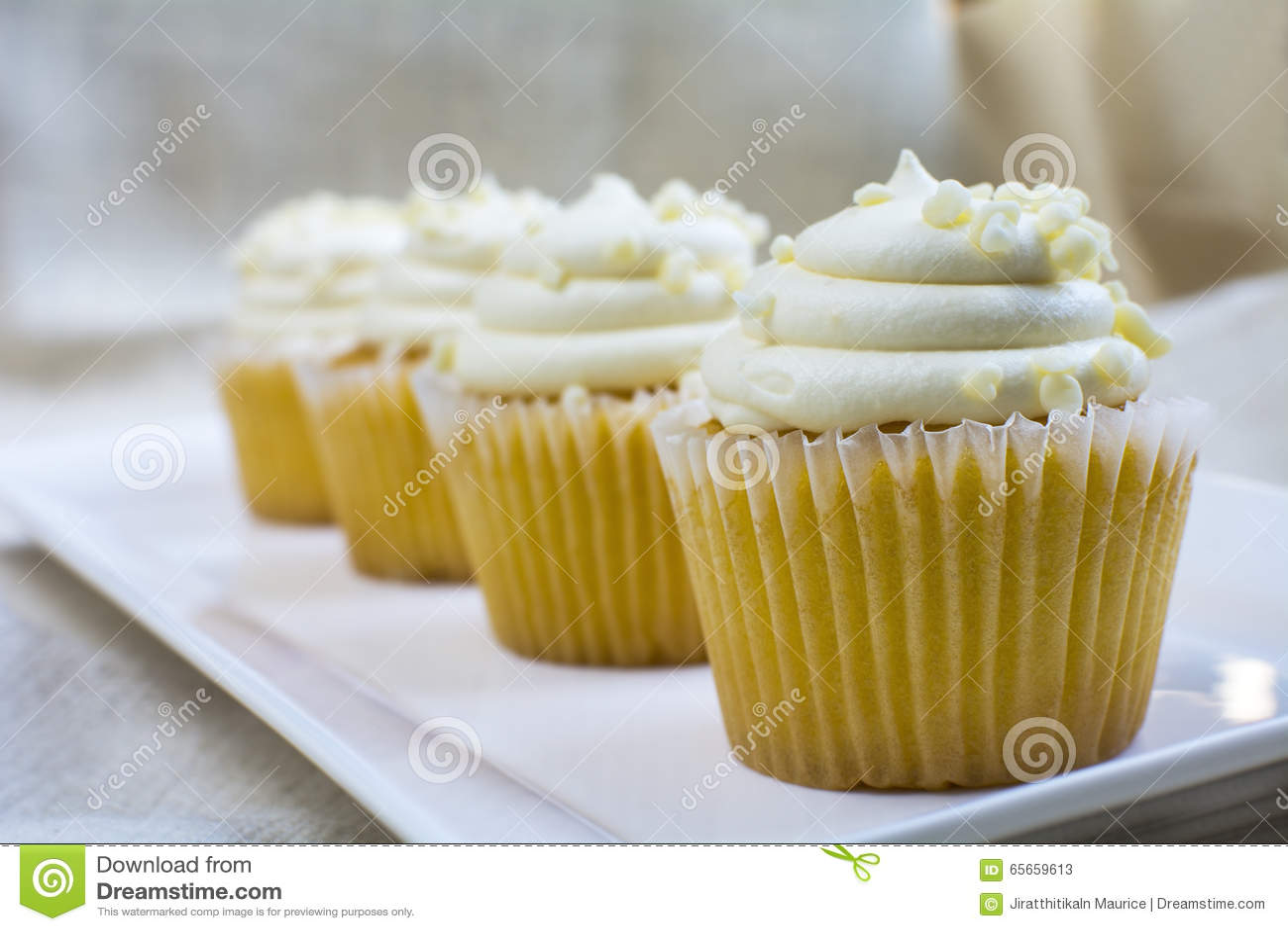 Four French Vanilla Cupcakes Dessert Stock PhotoImage65659613