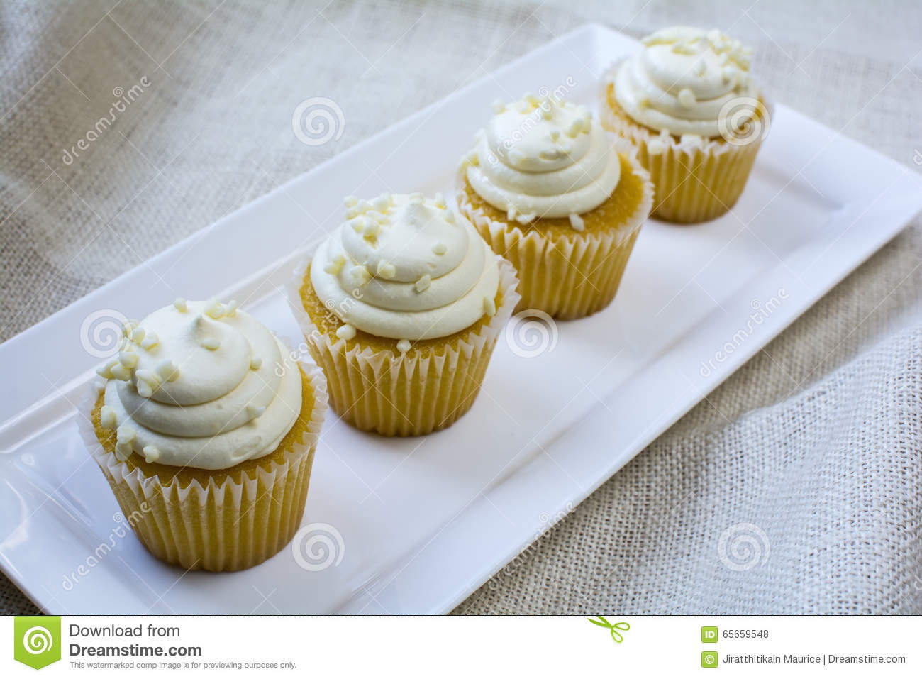 Four French Vanilla Cupcakes On White Square Plate Stock Photo