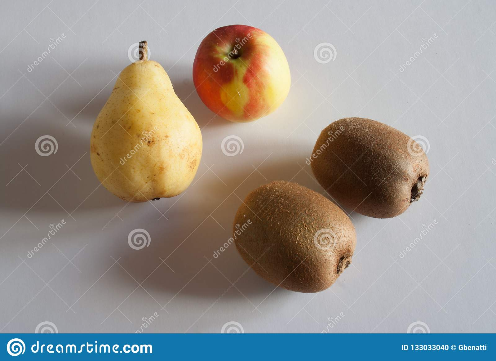 Four fruits with apple pear and two kiwis