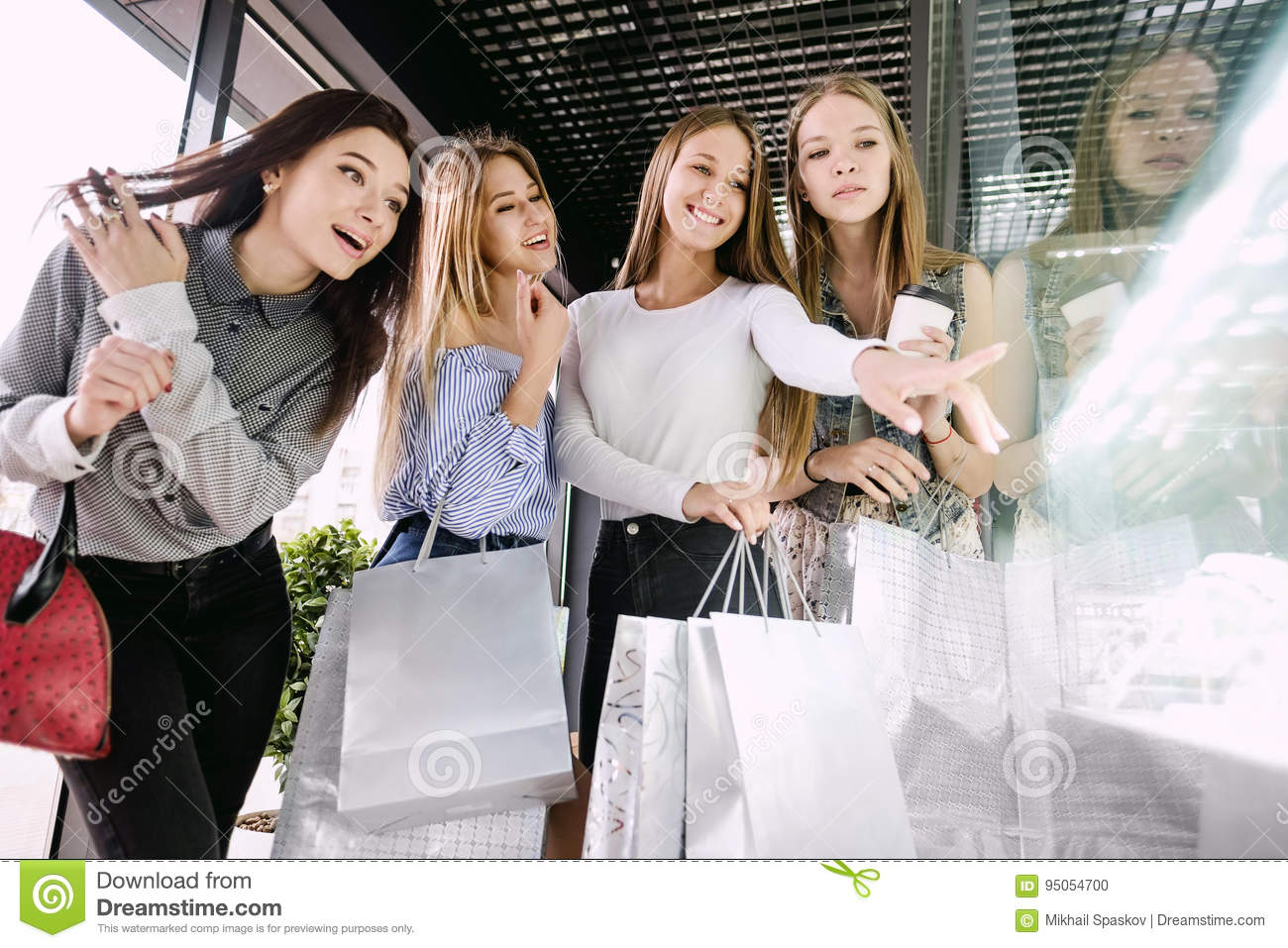 Four Girls Shopping At The Mall