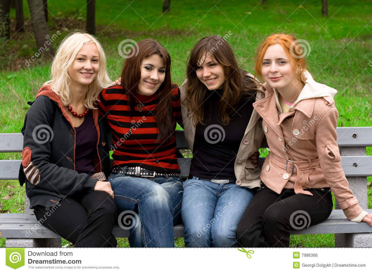 Four Girls Sitting On A Park Bench Stock Photo Image