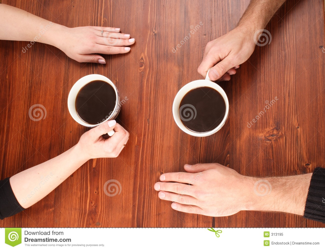 Four Hands On The Table Royalty Free Stock Photo - Image: 313195