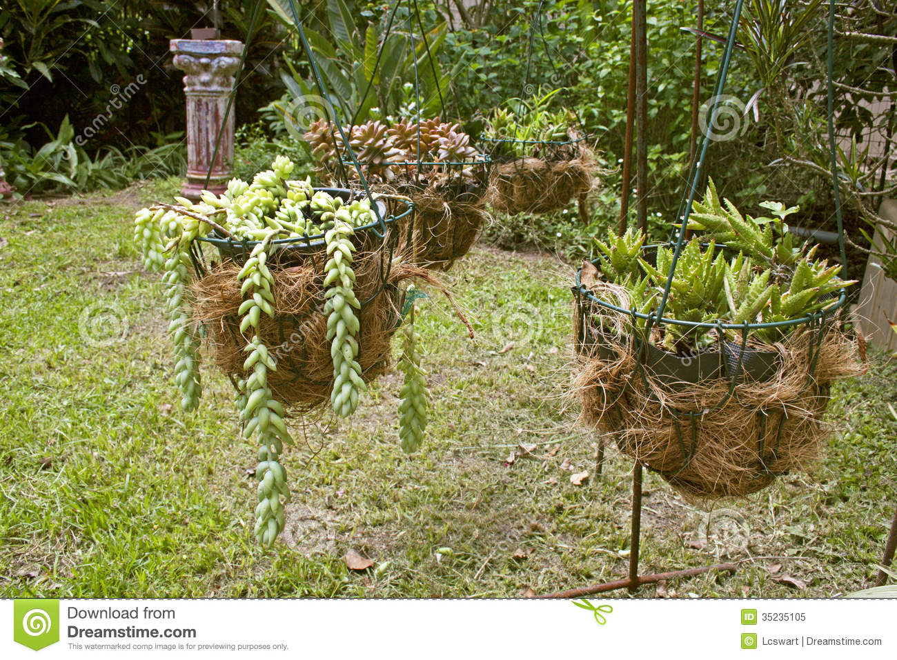 Four hanging flower basket arrangement in garden setting for Garden arrangement