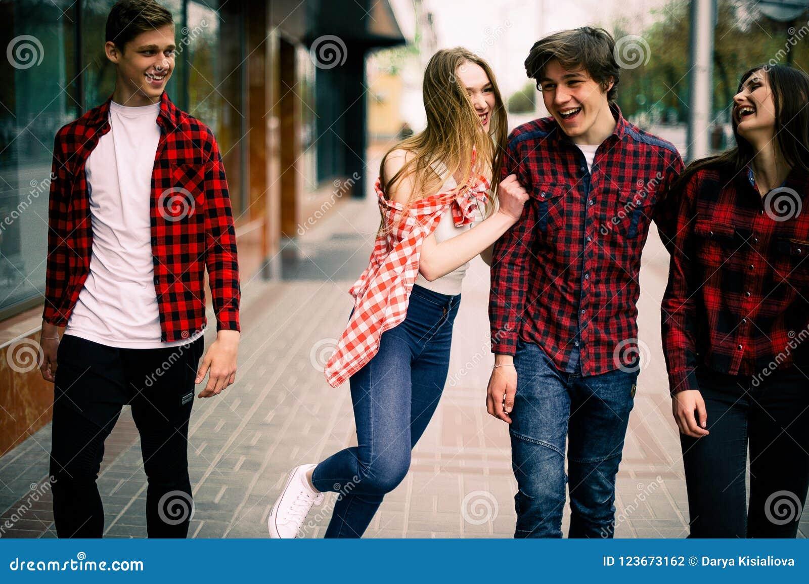 Four Happy Trendy Teenage Friends Walking In The City