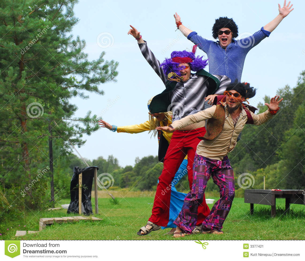 Four hippies jumping up