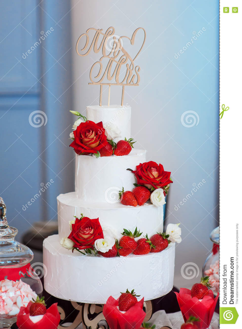 Four Layer White Wedding Cake With Red Roses And Strawberries Stock Image