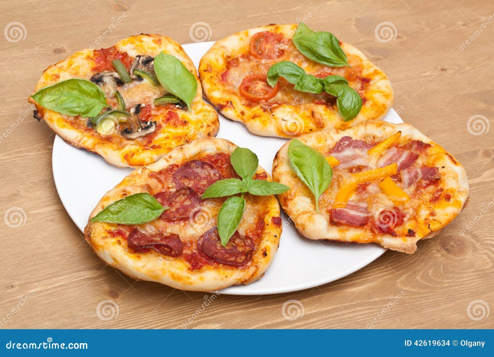 four mini pizzas stock photo image 42619634. Black Bedroom Furniture Sets. Home Design Ideas
