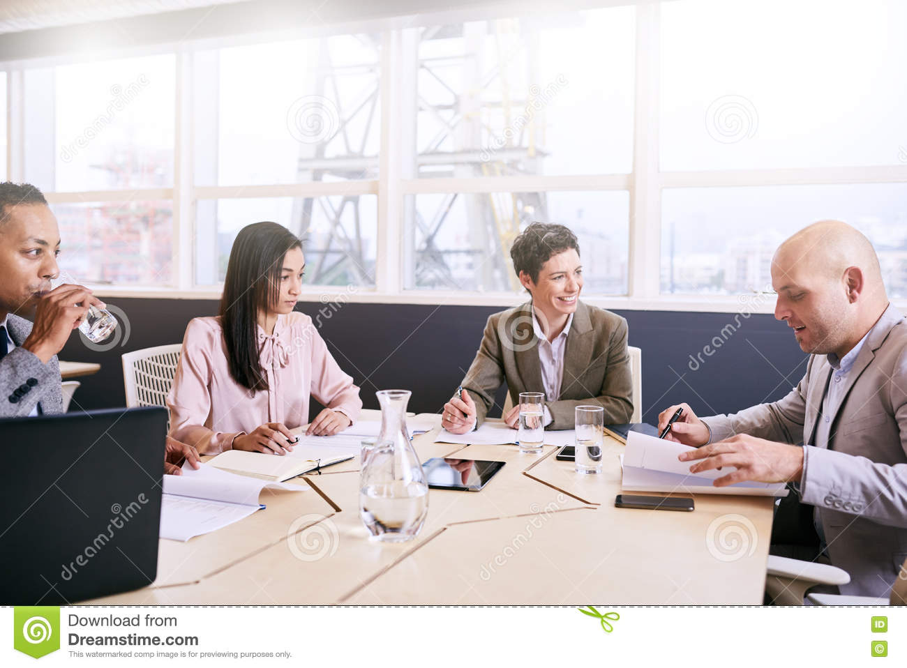 Four professional executives conducting a early morning business meeting