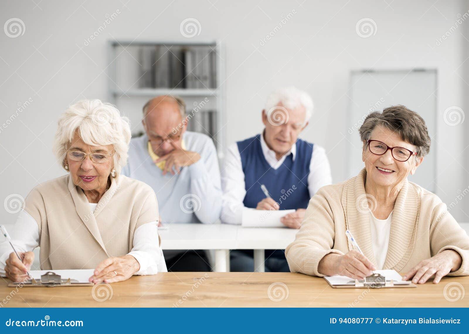 Four seniors during computer classes