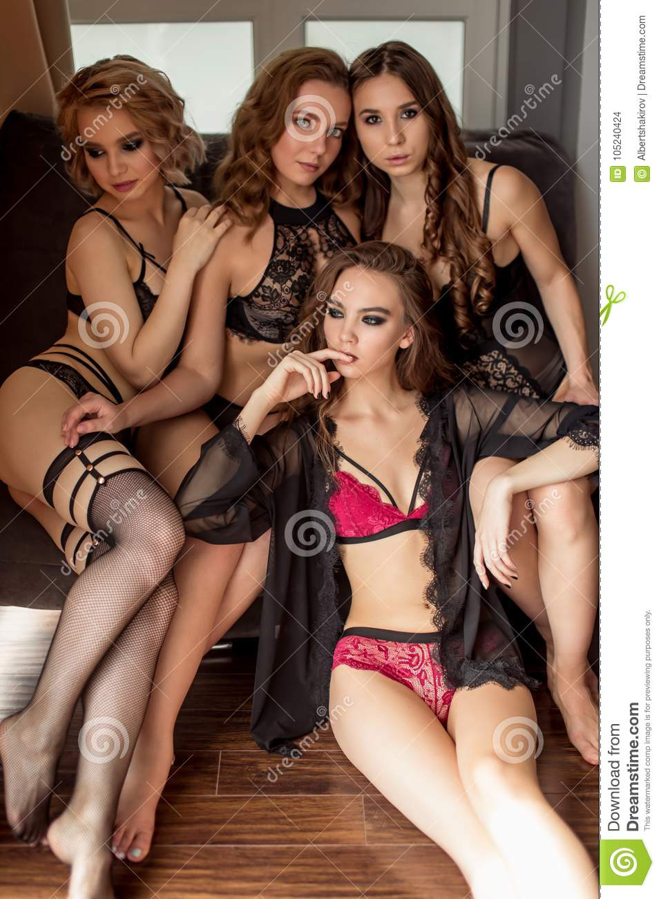 Four Models Posing In Lingerie