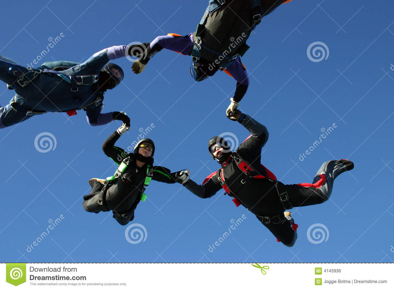 Four skydiver form a circle