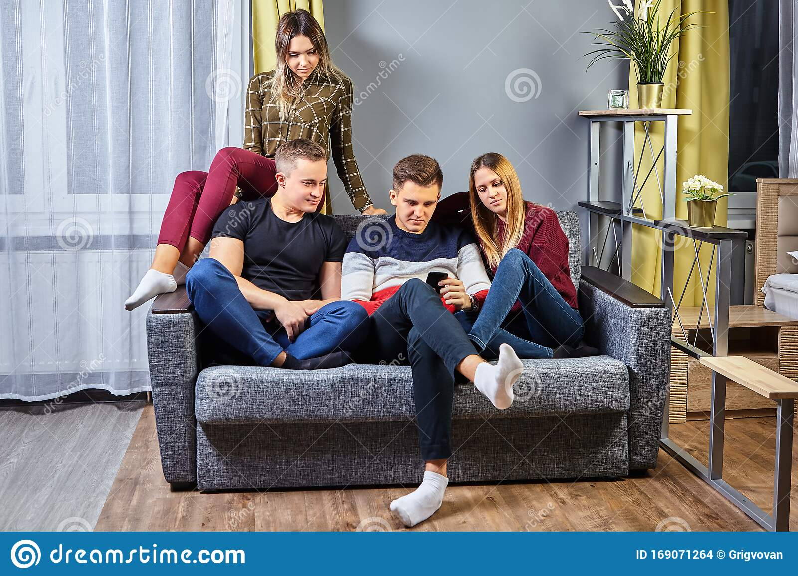Four Students In A College Dorm Room Stock Photo Image Of Boyfriend Four 169071264