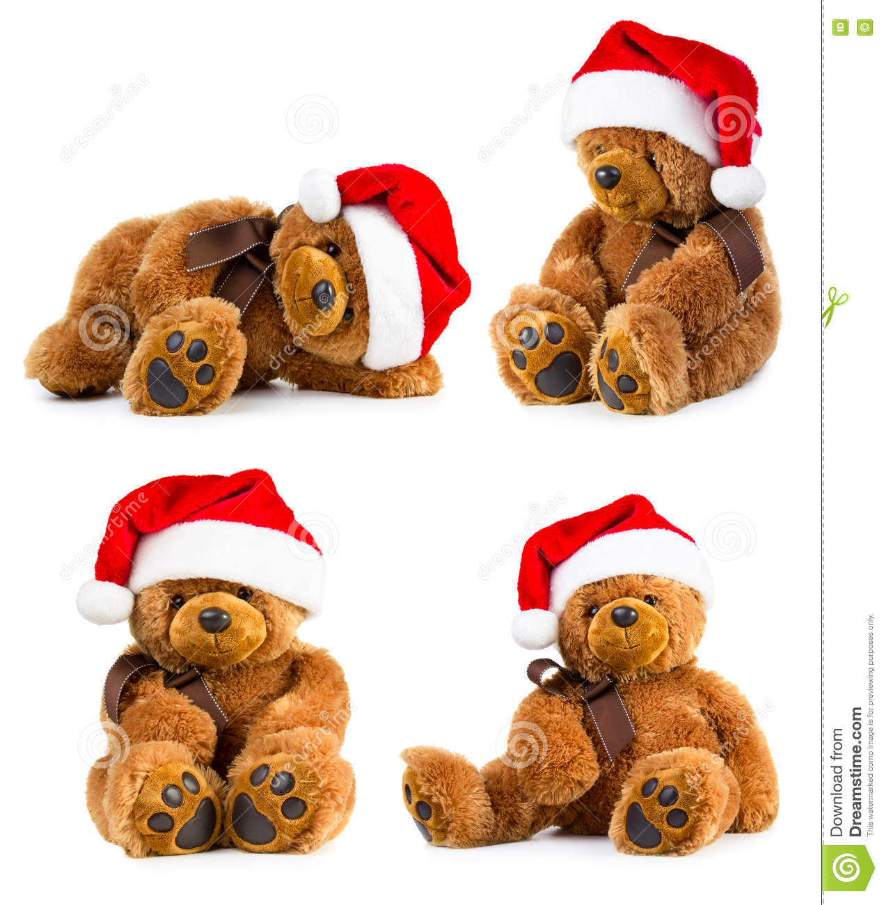 b149f1d27db83 Four toy teddy bear wearing a santa hat isolated on white background
