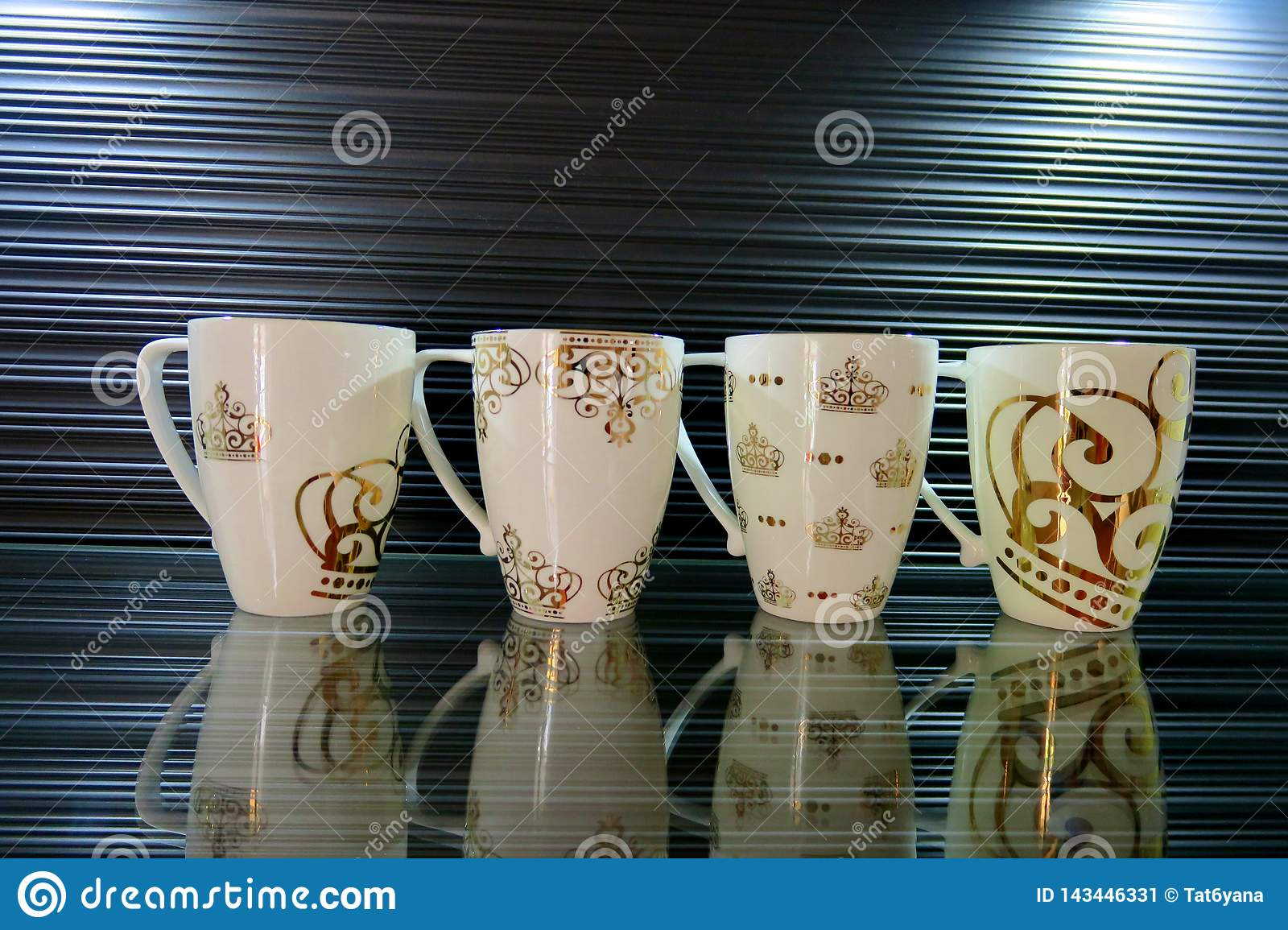Four white cups with different patterns on a beautiful background