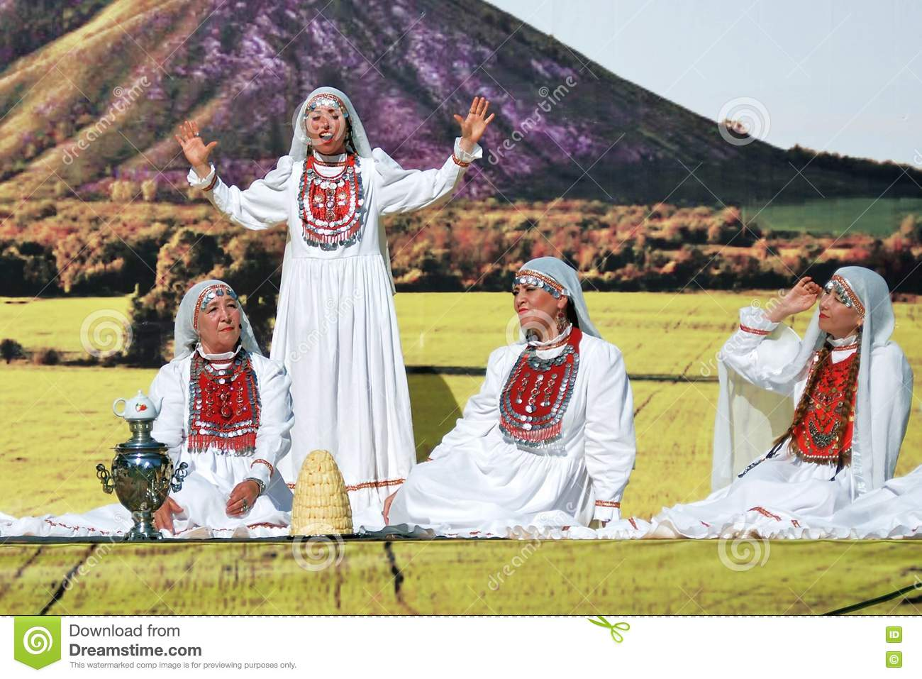 Four women in traditional Tatar dresses