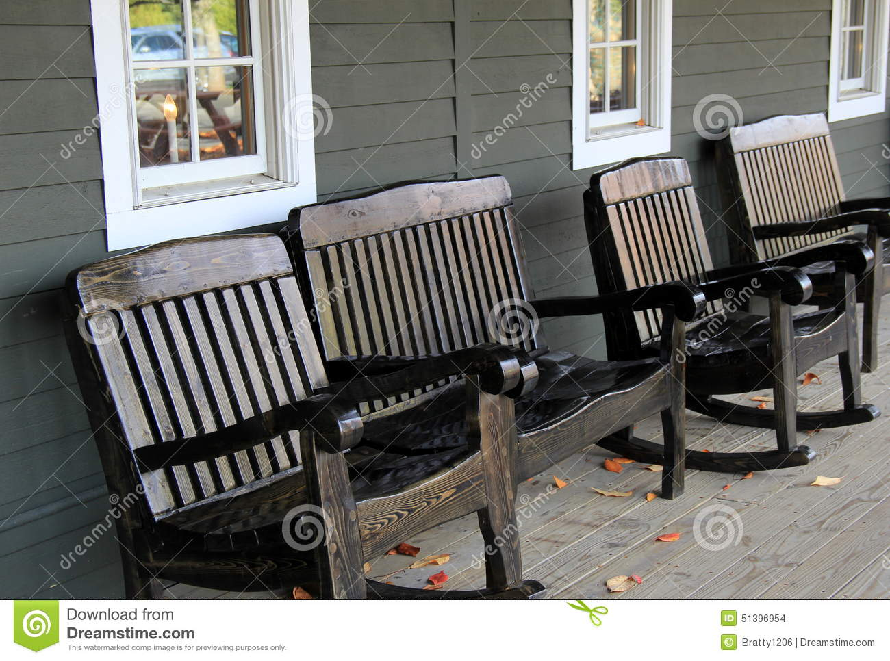 Four wood rocking chairs on front porch stock photo for Front porch furniture sets