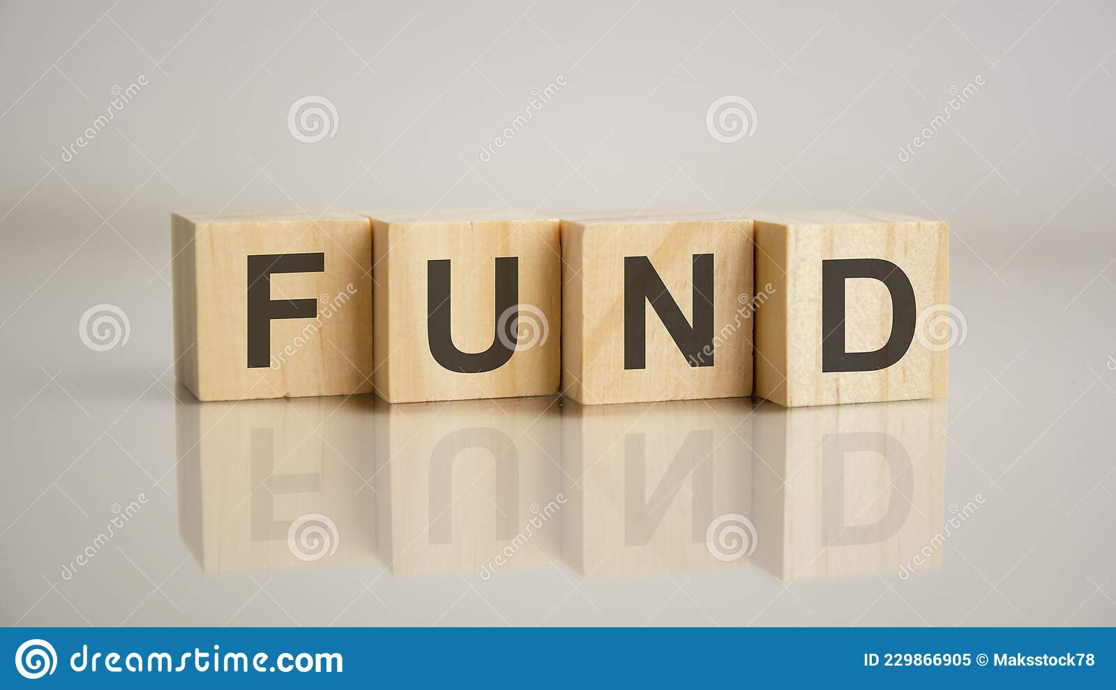 Four Wooden Cubes with Letters Fund. Business Marketing ...