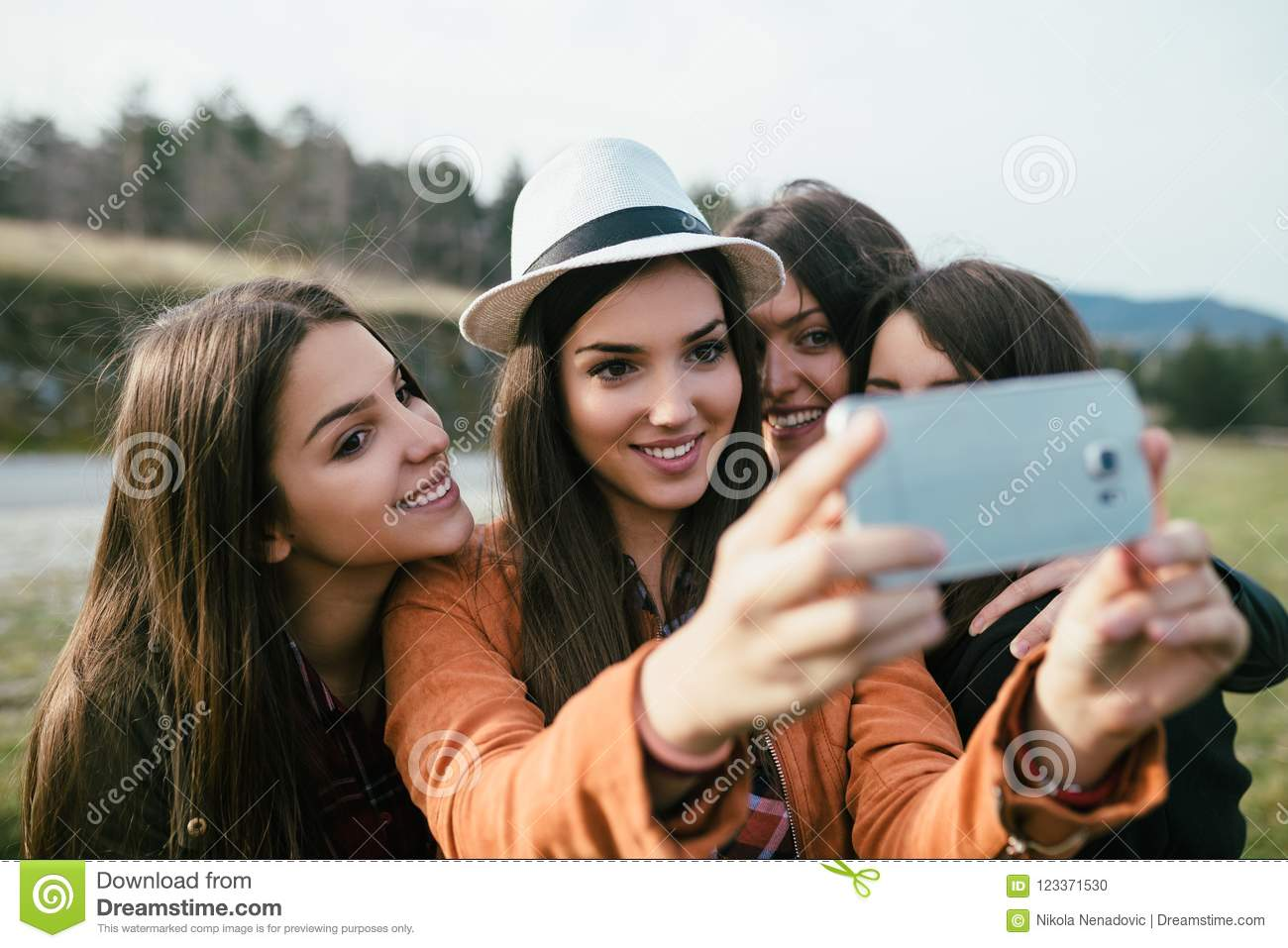 Group of four young women outdoors