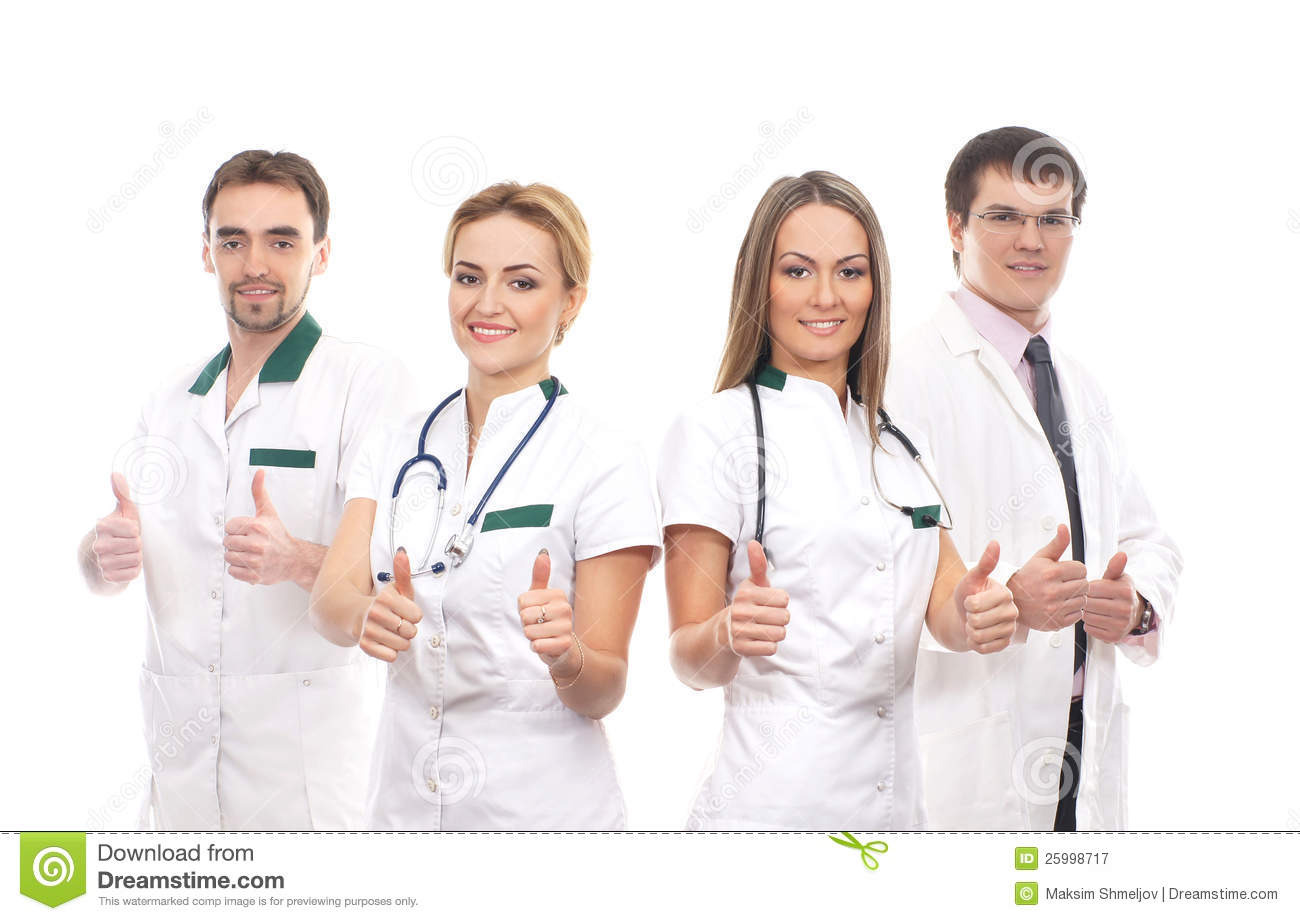 Four young medical workers holding thumbs up