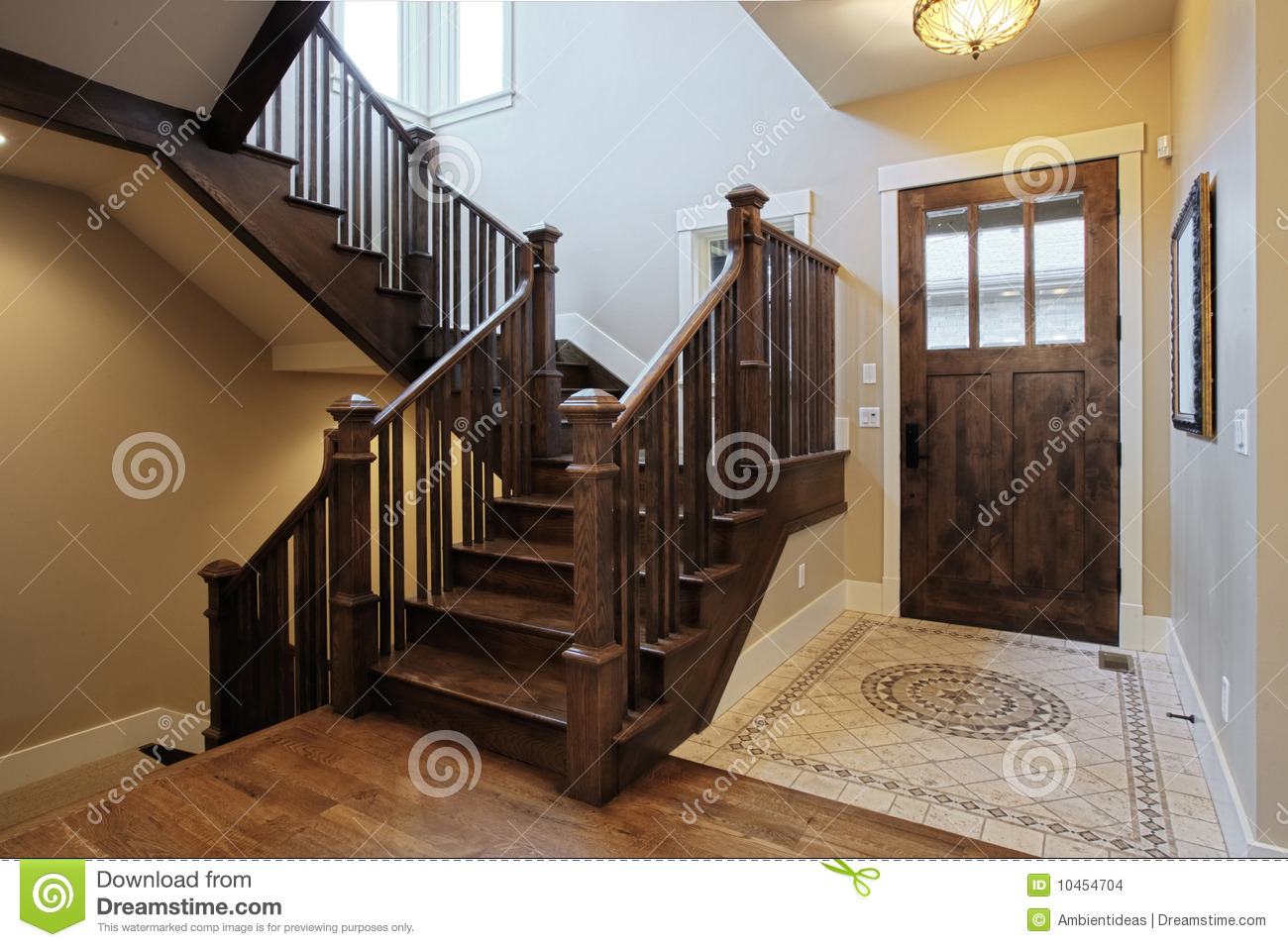 Elegant home foyer with wood stairs and flooring - Interior Home ...