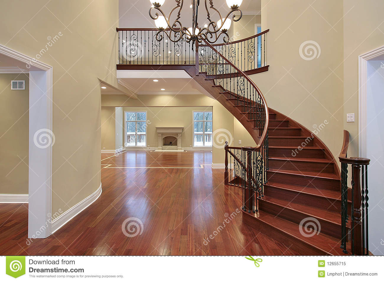 Foyer With Balcony And Curved Staircase Stock Image