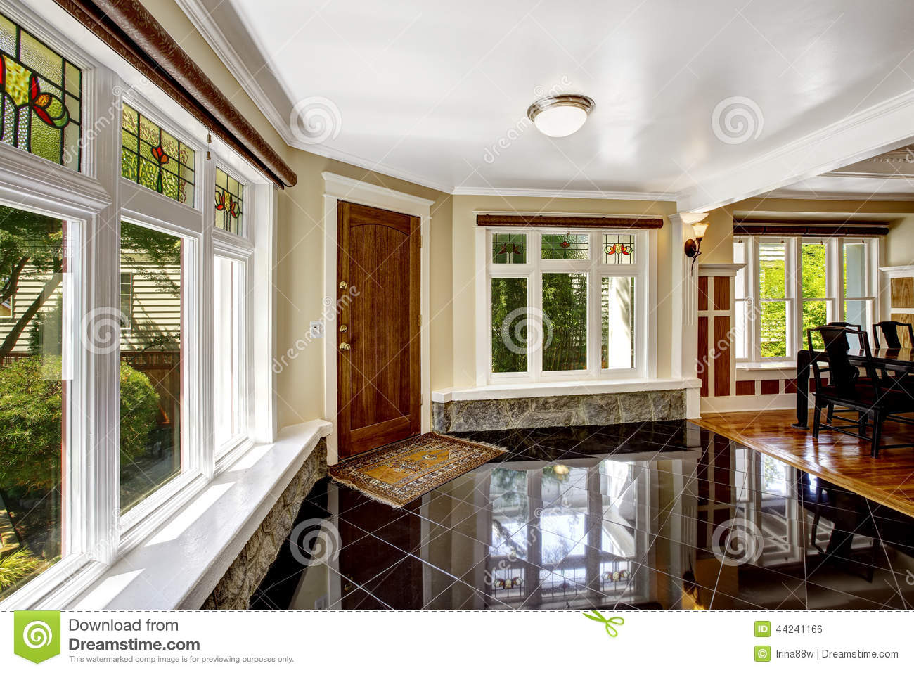 Foyer with black shiny tile floor and stone trim under the windo foyer with black shiny tile floor and stone trim under the windo doublecrazyfo Image collections