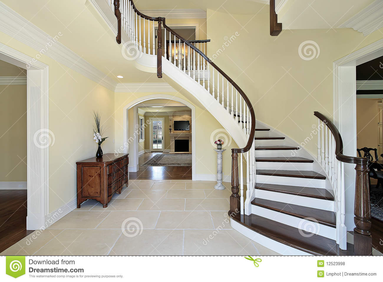 Foyer with curved staircase stock photo image of room for Escaleras de cemento para interiores