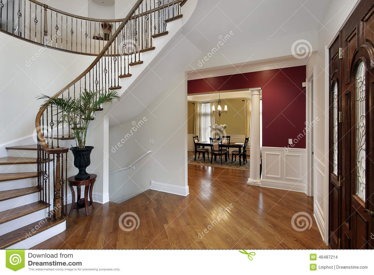 Foyer Luxury Kitchen : Foyer in luxury home with curved staircase stock photo