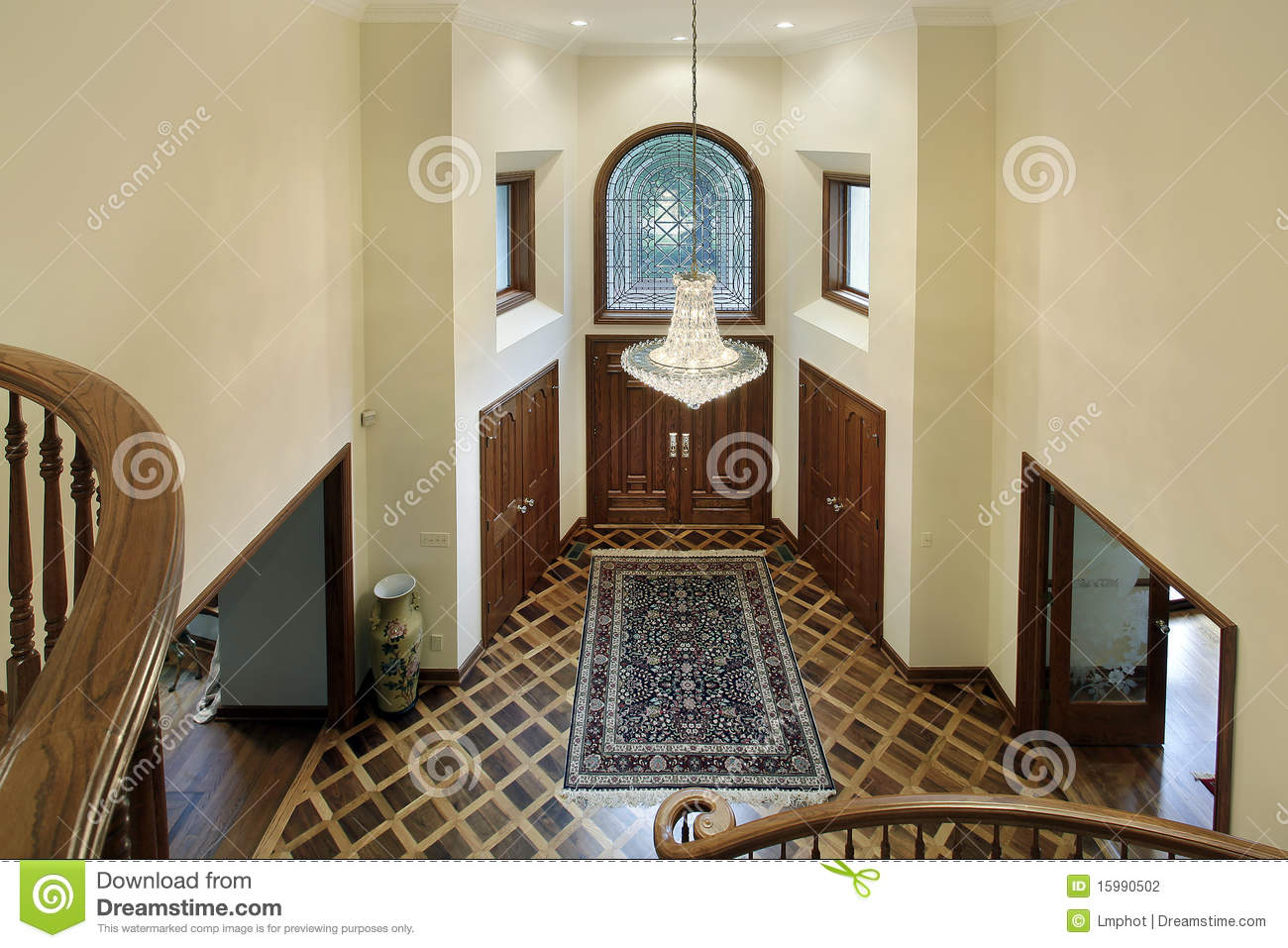 Foyer with oval glass window stock photography image for Luxury home windows