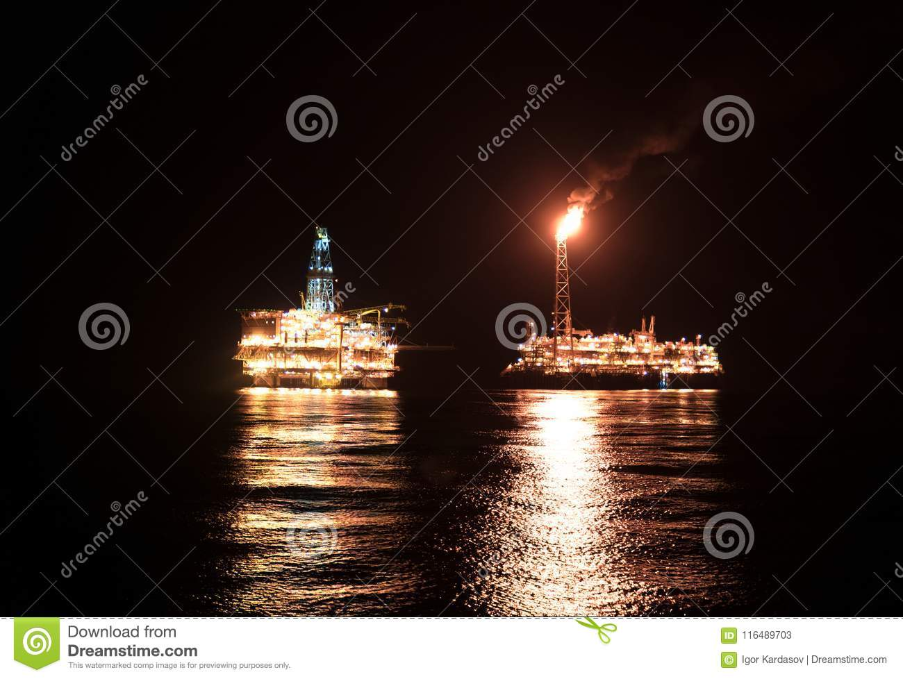 FPSO Tanker Vessel Near Oil Rig At Night  Offshore Oil And