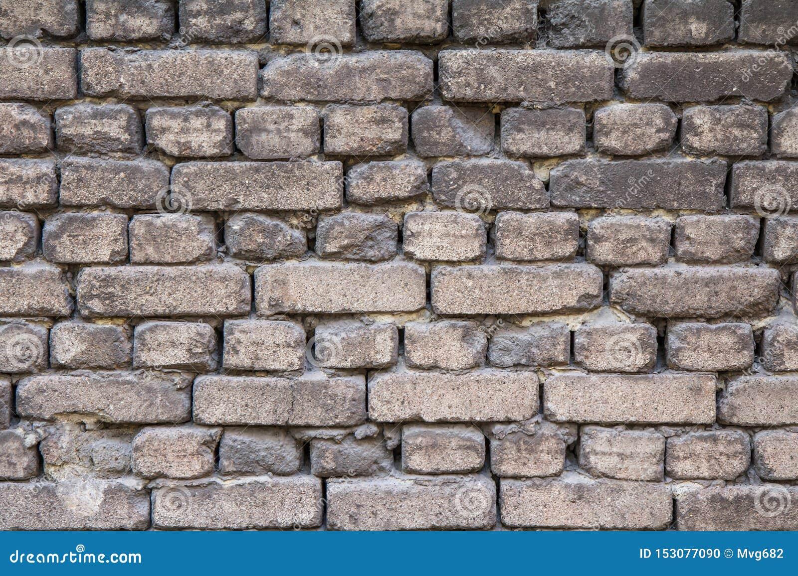 Främre sikt av tegelstenväggen i grå färg