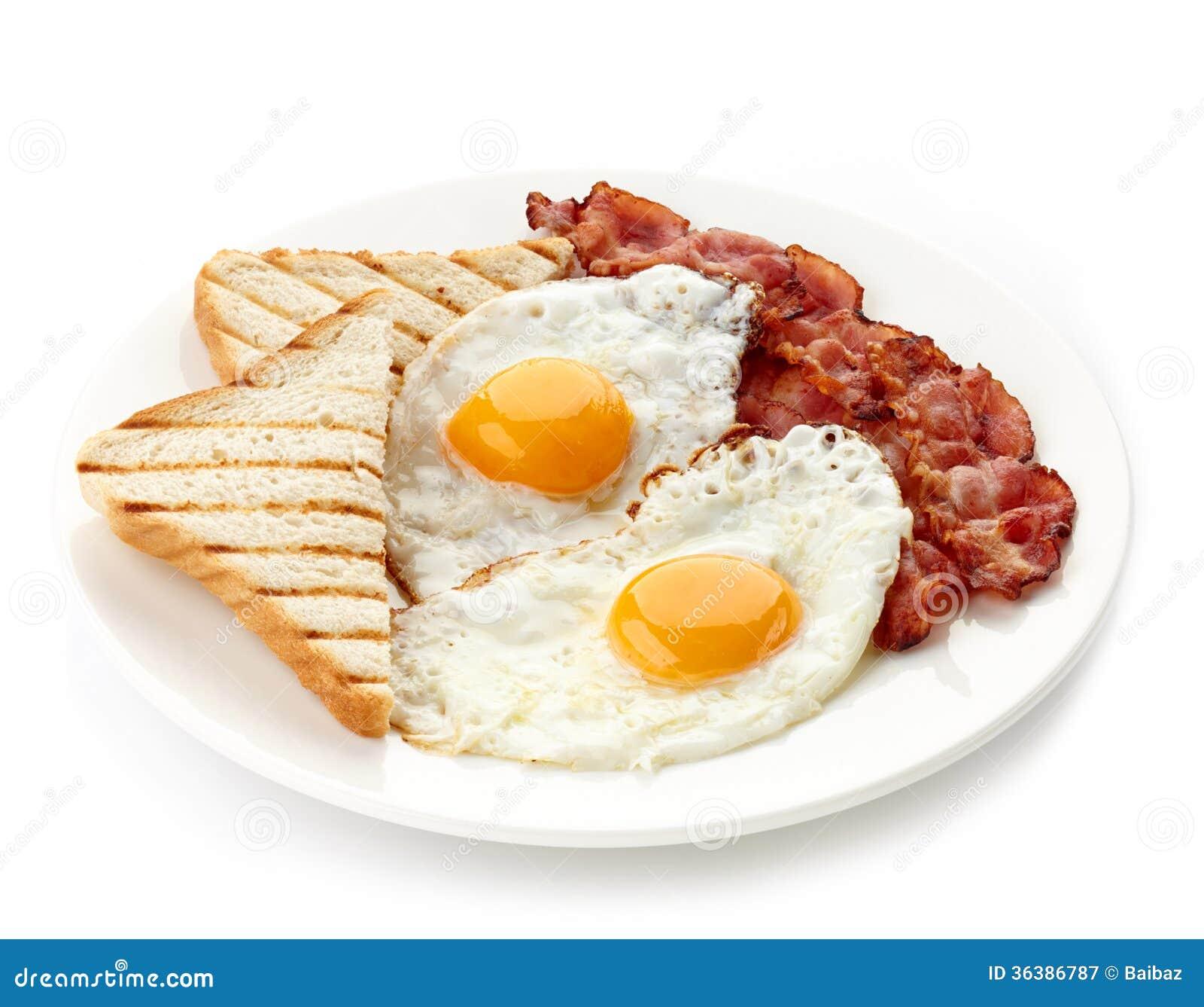 Frühstücken Sie mit Spiegeleiern, Speck und Toast