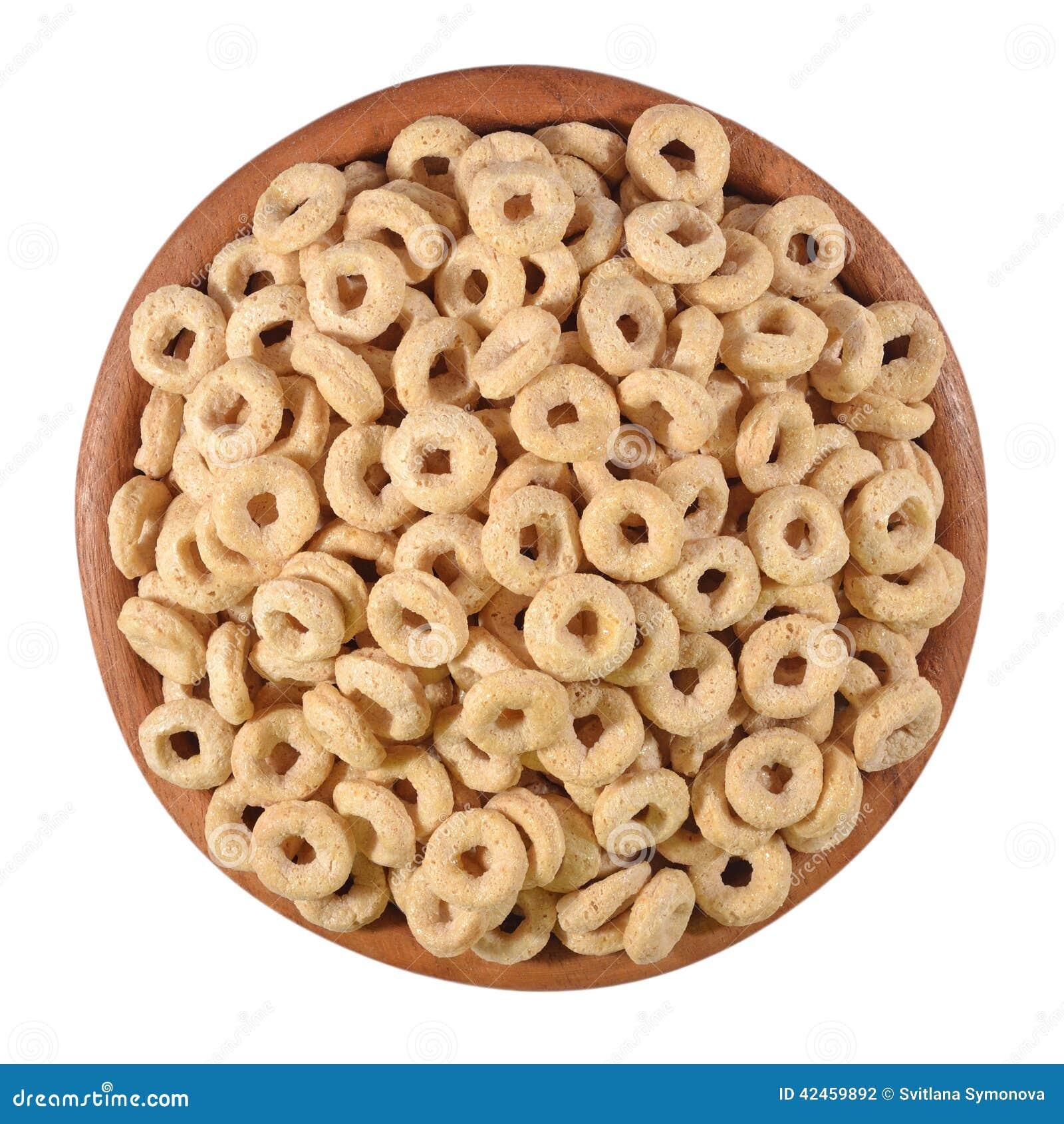 Frühstückskost aus Getreide schellt in einer hölzernen Schüssel auf einem Weiß