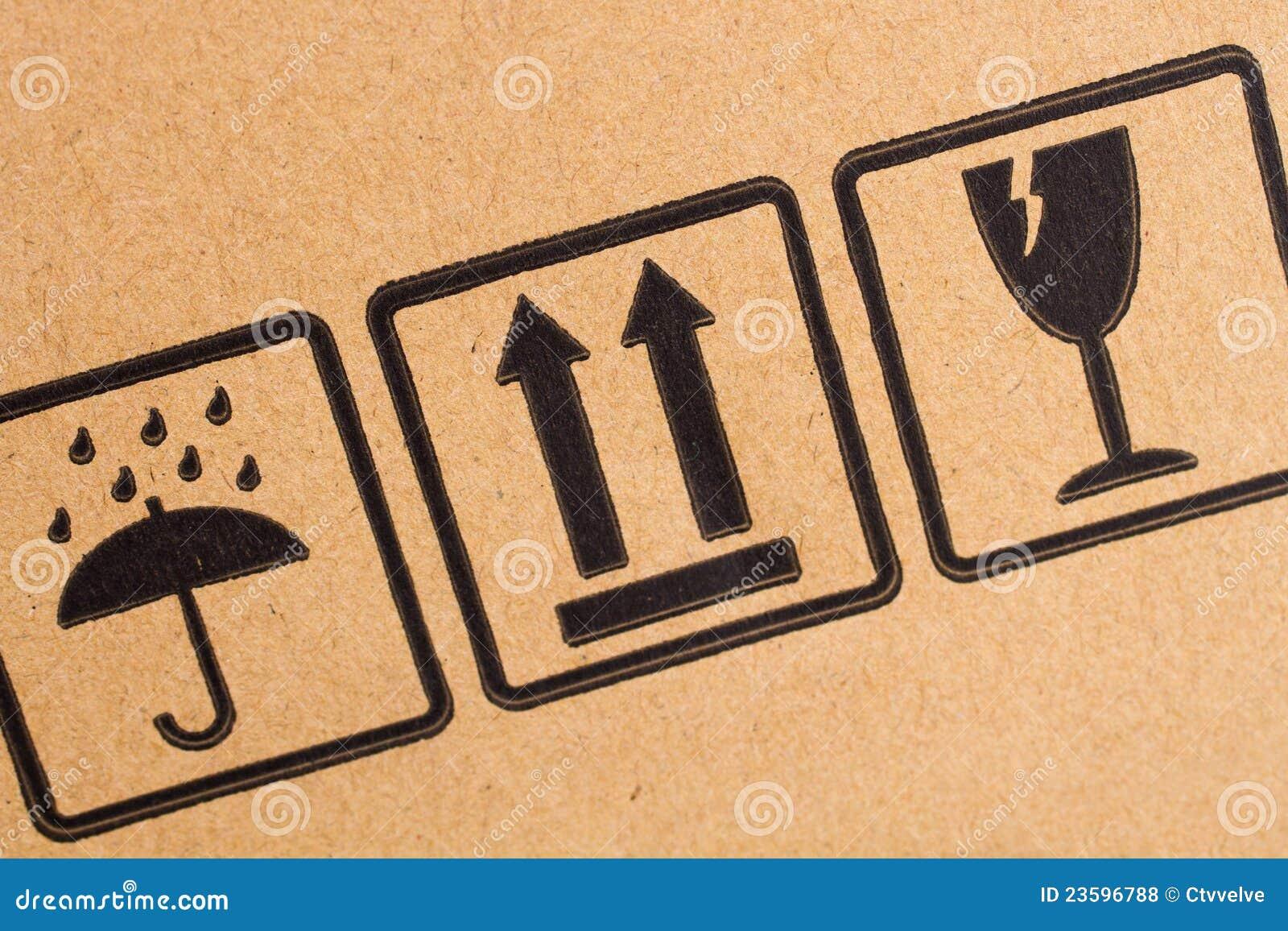 Fragile symbols on cardboard