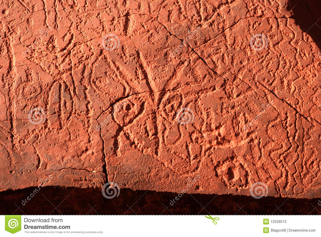 Fragment of aboriginal rock carving stock image