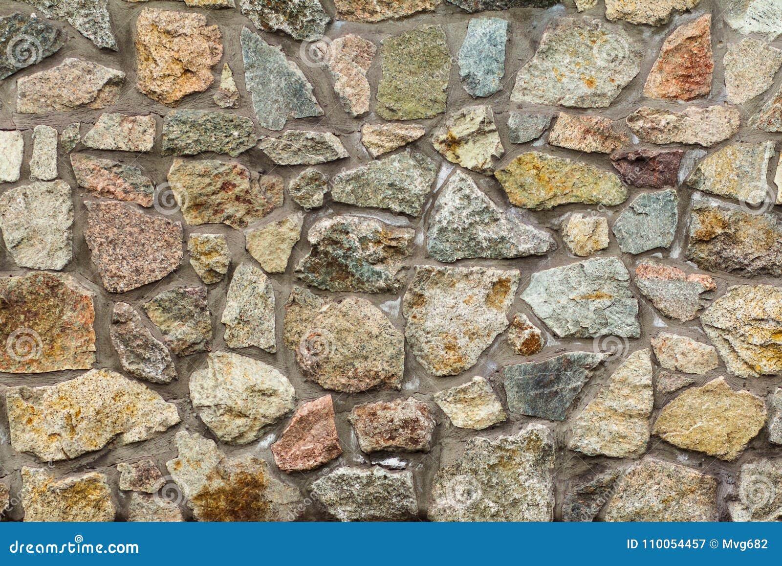 Fragment av den gråa stenväggen Bekläda beskådar