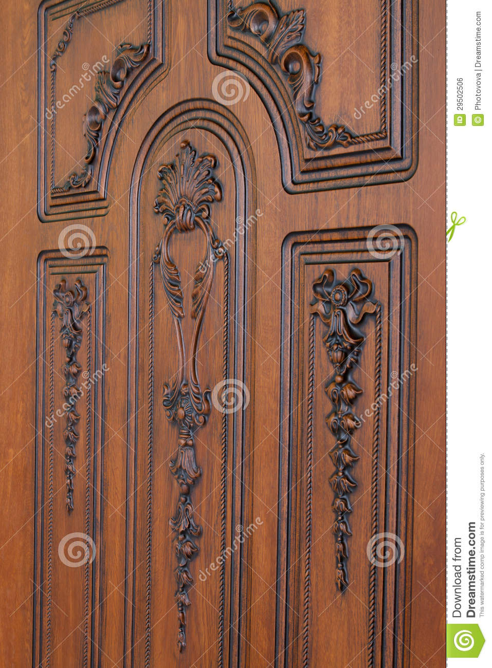Fragment beautiful carved brown wooden door royalty free for Beautiful wooden doors picture collection