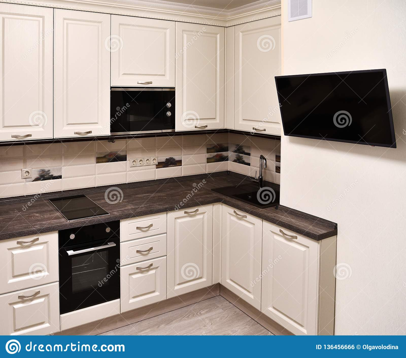 Fragment Of Beige Kitchen And Tv On The Wall Stock Photo Image Of Cabinet Sink 136456666