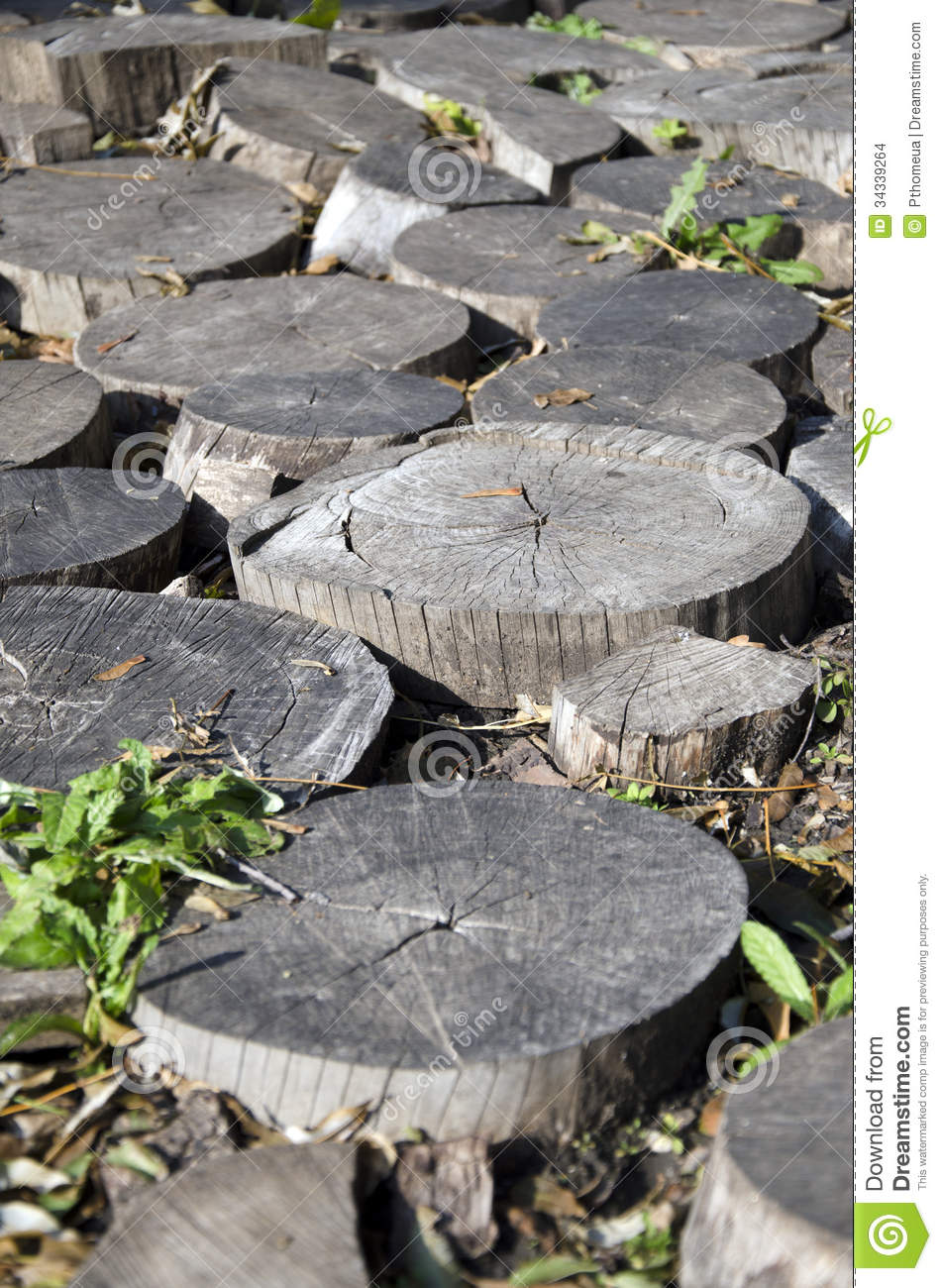 fragment of garden decor of wood scraps round logs portrait, Gardens/