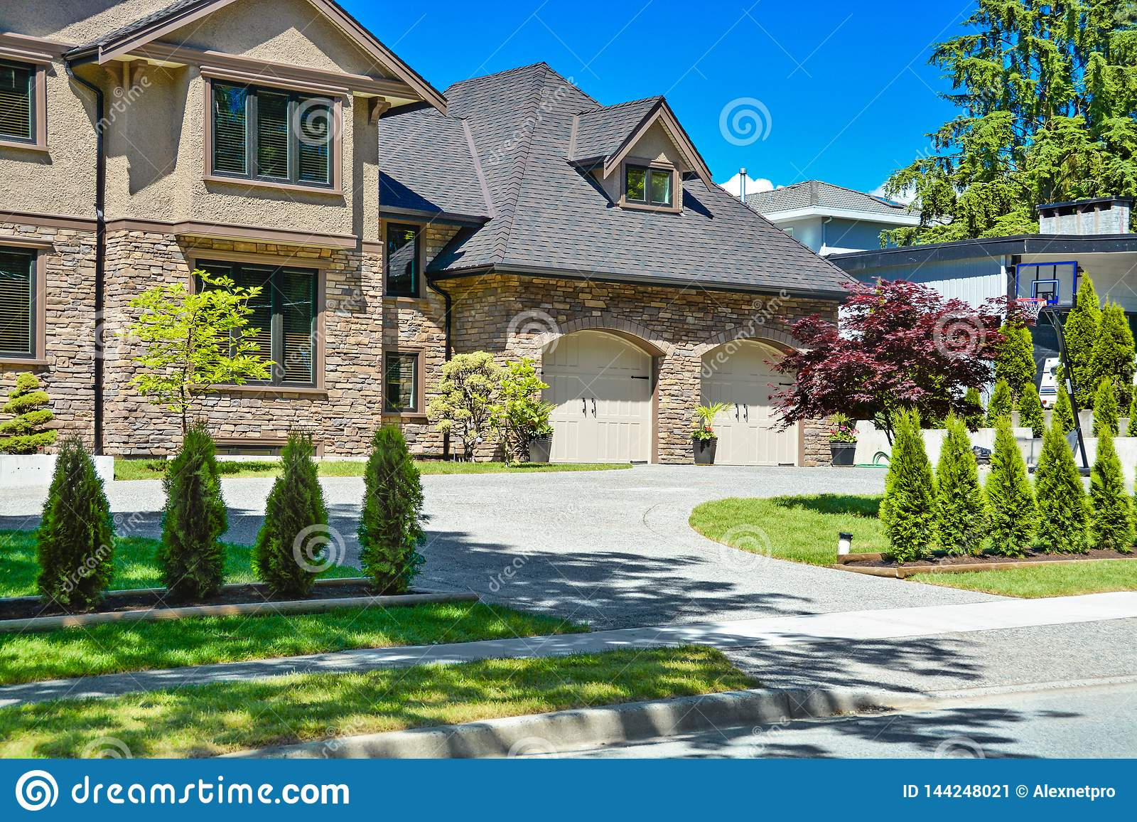Fragment Of Luxury House With Double Garage And Concrete Driveway In Front Stock Image Image Of Modern Front 144248021