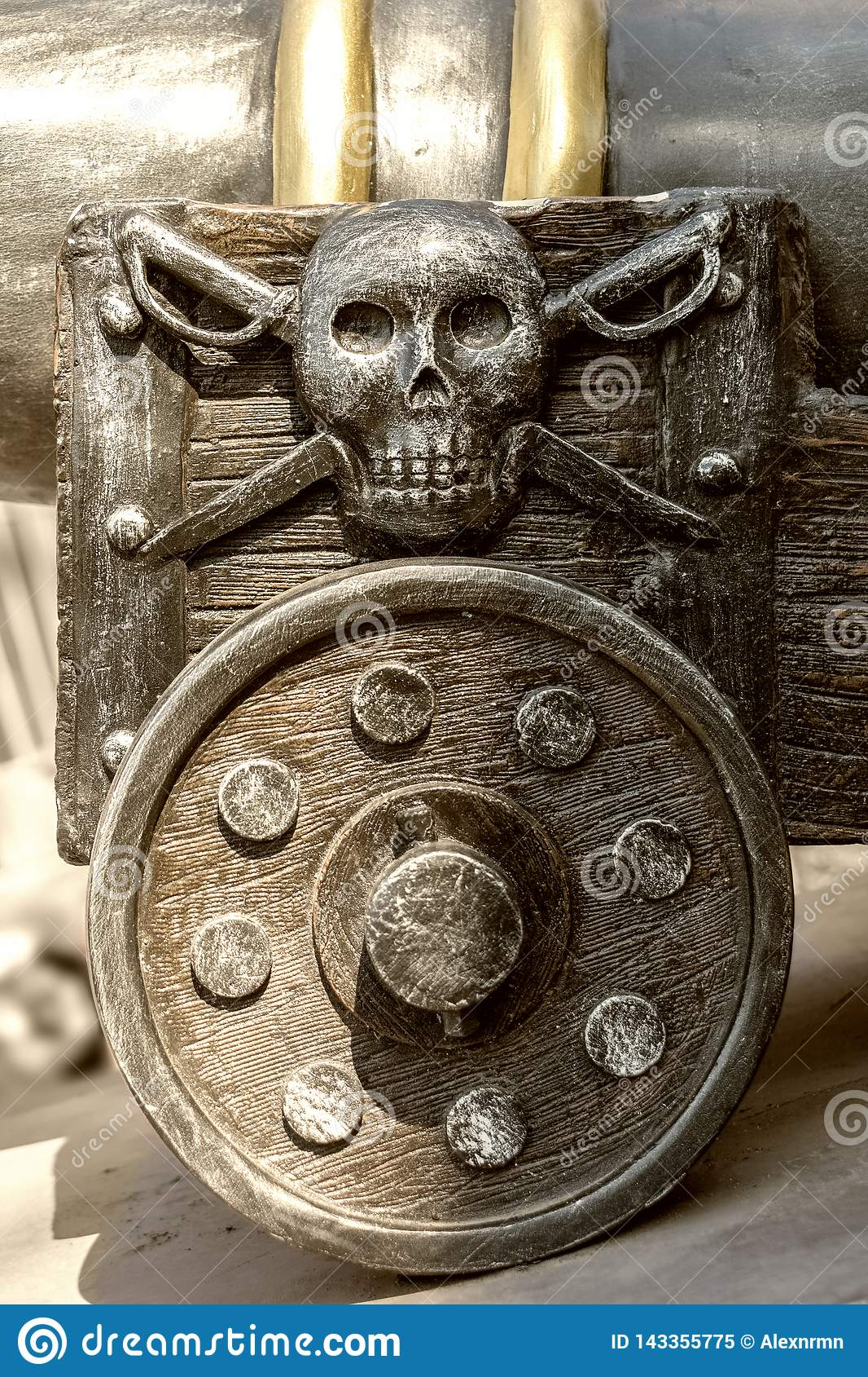 Fragment of an old gun carriage with a pirate emblem.